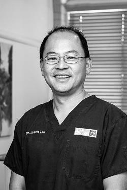 Dr Justin Tan